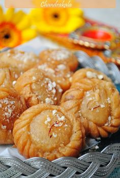 Chandrakala/Sweet deep fried treats stuffed with milk solids and soaked in sugar syrup.