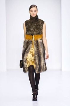 Salvatore Ferragamo F/W 2014. Fur is back with a vengeance. It's so beautiful but how can we be nodding to its use on the runways in the face of so many extinctions?