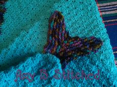 "Here is a mermaid tail cocoon pattern that gives the illusion of scales without all the bulk of actual crocodile scales!! It works up quickly and has three different children's sizes. What is more fun than to curl up with your favorite book in such a cool blanket!!! You can also stitch up the cute little ""starfish friend"" to accent the front!!!"