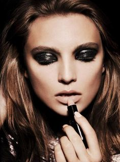 Smokey eye, nude lip.