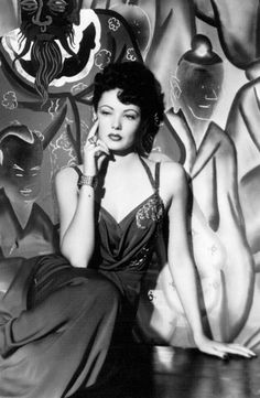 Gene Tierney, 1940s with Oriental influence in the costume and background; from the film Shanghai Gesture 1941