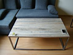 Industrial Coffee Table Handcrafted of Reclaimed Wood supported by Steel Frame.