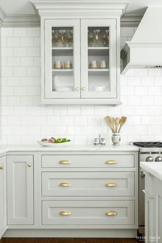 gray / green cabinets with white backsplash (but would do 3x6 subway instead of this more square shape) like the gray grout also