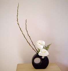 Ikebana - beautiful detail and contrasts with the black and white theme and the willow adds height.