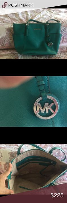 Real MK HANDBAG GREAT CONDITION  the color This is a nice bag in great condition clean some ink on the bottom nothing big other then that is clean Michael Kors Bags Shoulder Bags