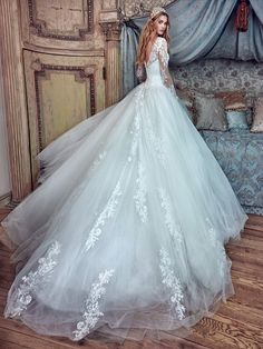 from Galia Lahav Le Secret Royal Collection: Corina is a princess ball gown with a tiny sweetheart corset and a full skirt. It is made of silk satin tulle, french chantilly lace and delicate appliques that adorn the train of the full voluminous skirt. The gown is entirely decorated with clear crystals and has long sleeves.