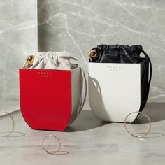 Marni's famous exploration of sculptural silhouettes results in this charming Coffer bag, crafted wi Black Clutch Bags, Leather Clutch Bags, Bucket Bag, Round Bag, Purse Styles, Drawstring Pouch, Handmade Bags, Small Bags, Purses And Handbags