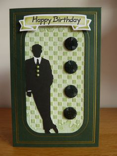 A pinspired card using Cricut Suburbia for the leaning man. Coredination Whitewash card embossed with a Sizzix embossing folder and distressed. Spellbinders banner and vintage buttons.