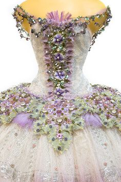 The costumes are designed and hand made in London by award winning costume designer Vinilla Burnham, using period silks, antique lace and embroidery, appliqué, crystals and original 1920's gelatine sequins.