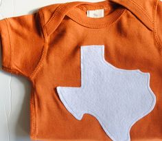 Texas Onesie: burnt orange and white.     Pinned by http://high5collegeclub.com