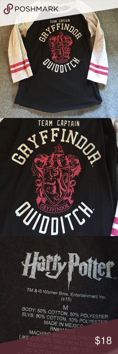 Harry Potter Gryfindor Quidditch shirt! Mid sleeve t-shirt from Spencer's for Harry Potter fans! Worn only once, and fits nicely Warner Bros Tops Tees - Long Sleeve