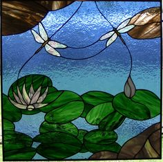 dragonflies -- this one's done in stained glass, but I think it would make an awesome mosaic!