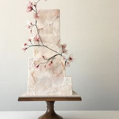 Modern wedding cake with a torn-paper effect More