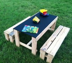 This kid's activity table with a chalkboard table top is pretty great - could probably DIY as well! (maybe even out of PALLETS!!!)