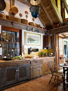 A perfect example of the rustic kitchen style. Enhance the woodwork by using white shades of Sherwin-Williams paint.