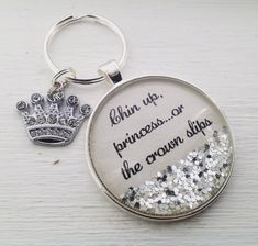 """Princess personalized keychain with sparkles. """"Chin up princess.or the crown slips"""" personalized keychain with sparkles. This piece measures around and comes as seen with adorable rhinestone crown charm in silver finish. Gifts For Teens, Gifts For Women, Crown Quotes, Diy Keychain, Keychains, Coupons By Mail, Cinderella Birthday, Diy Crown, Chin Up"""