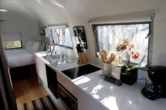 '59 airstream 26' overlander, queen bed in rear, sleeper sofa in front, strand bamboo flooring, all-electric kitchen features cook top, convection microwave oven, refrigerator, air conditioner, heater and white corian counters