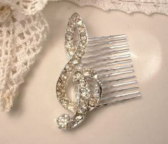 Vintage Clear Rhinestone Musical Note Hair Comb by AmoreTreasure, $73.99 Ah, this is so me, but it's not in my budget right now.
