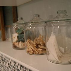 Glass jars of different sizes. Use one for lost change, one for clothespins, one for dryer sheets