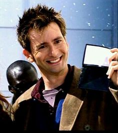 The Tenth Doctor shows the psychic paper