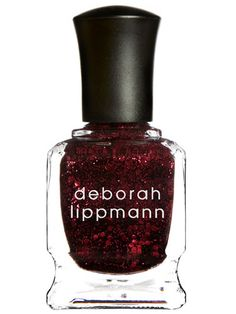 10 Best Sparkly Nail Polishes for Holiday Festivities: Nail Lacquer in Ruby Red Slippers, $18, Deborah Lippmann.