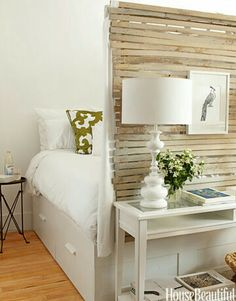 8 Ways Designers Use Ikea - the foot board could actually work to make the bed super cozy and the flip side to display a full lenGth mirror facing the cupboard wall!