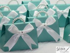 Super cute Mini Breakfast at Tiffany's Blue Paper Purses. Such a great idea for party favors at your Breakfast at Tiffany's themed Bridal Shower! Made by Gvites! http://etsy.me/1fLdjNN