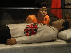 Back from the dead: Imelda Marcos plants ghoulish kiss on glass coffin of embalmed husband as she resurrects political career