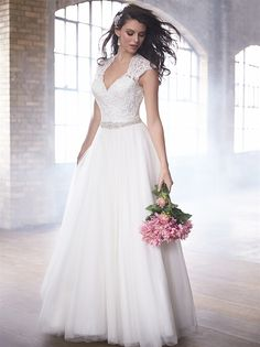 Cap sleeves and a keyhole back adorn this A-line lace and tulle gown.
