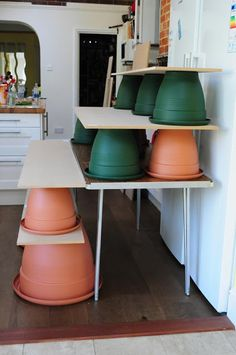 """create """"shelves"""" with flower pots and wood. Would be light & easy to transport"""
