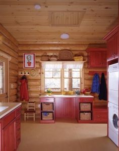 Log home laundry room with red cabinetry