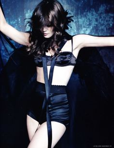 Vanessa Paradis in an all-black Chanel lingerie set