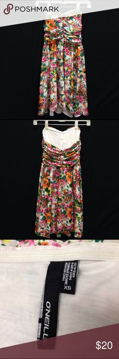 O'Neil Spring Floral Strapless Dress Bust 26-29 Waist 22- 24 Length 25. This dress is in like new condition. It has the glue strip that goes around most strapless bras these days. A unique feature about this skirt it it has no hem. It does not thread though as it has been washed once and is still in pristine condition. O'Neill Dresses Strapless