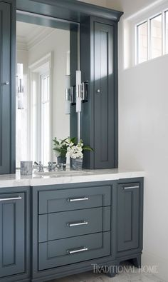 The blue-gray cabinetry in his master bathroom is crisp and sophisticated. - Photo: Emily Jenkins Followill / Design: Melanie Turner