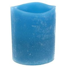 "Mimic the ambience of a real wax candle without the worry of a burning flame with this Blue Distressed LED Votive.    	Votive Details:    	  		Width: 2""  	  		Height: 2 1/2""  	  		Real wax feel  	  		One CR2032 mercury-free battery (included)  	  		On/off switch"