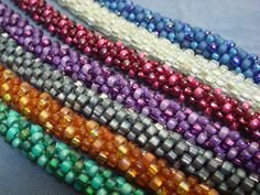 Kumihimo beaded bracelets.  I want to learn kumihimo!