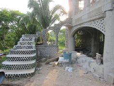 I know these are stairs, and I hate the exposed glass bottles (so tacky), but I do like the idea of having a cascade waterfall build similar to this, with archways aquaduct leading the water there.