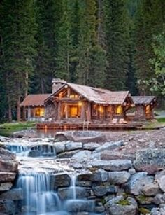 beautiful log home overlooking a river & falls