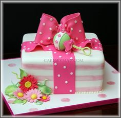 baby shower cake! @Megan Ward Ward Spann, this is too cute! Is this kind of what you were talking about?! The colors of the shower are hot pink, white and maybe a little lime green!