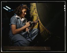 Riveter at work on Consolidated bomber, Consolidated Aircraft Corp., Fort Worth, Texas (LOC) by The Library of Congress, via Flickr