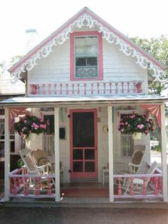what an adorable pink and white cottage