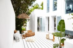Three Birds Renovations have totally transformed Lana Taylor's former house into a slice of Santorini-inspired heaven. Here we take a last look. Exterior Design, Interior And Exterior, Outdoor Spaces, Outdoor Living, Outdoor Lounge, Indoor Outdoor, Outdoor Decor, Santorini House, White Deck
