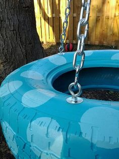 Cutest tire swing ever! This is handpainted and put together with eye screws and chain. Hook with spring clips to easily remove.