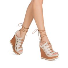 Get a sexy, summertime look with Donnica. She's got a leg-lengthening platform and a flattering caged, laced-up construction.