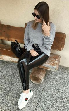 Black latex leggings sweater sneakers casual outfit in public