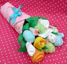 Baby clothes bouquet. Unique baby shower gift ideas