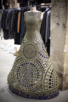 Wow, this dress looks it's made from concrete and tiles. It's a wearable mosaic.
