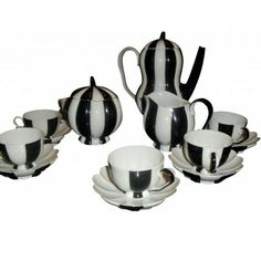 An Austrian Porcelain Mocha Coffee Service,, designed by Josef Hoffman (Austrian, 1870-1956), one of the founders of the Wiener Werkstätte. Made by Porzellanfabrik Augarten, Vienna. #Josef_Hoffman #tea_set
