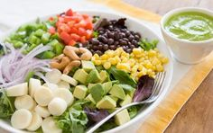 Brazilian Cobb Salad // This salad takes its inspiration from some classic flavors of Brazil: hearts of palm, corn, black beans, avocado and cashews! #summer #vegan #salad #recipe
