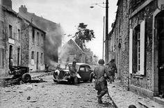 OCT 1 1944 US 82nd Airborne seizes prisoners for intelligence Robert Capa's image of the 82nd fighting in Normandy.